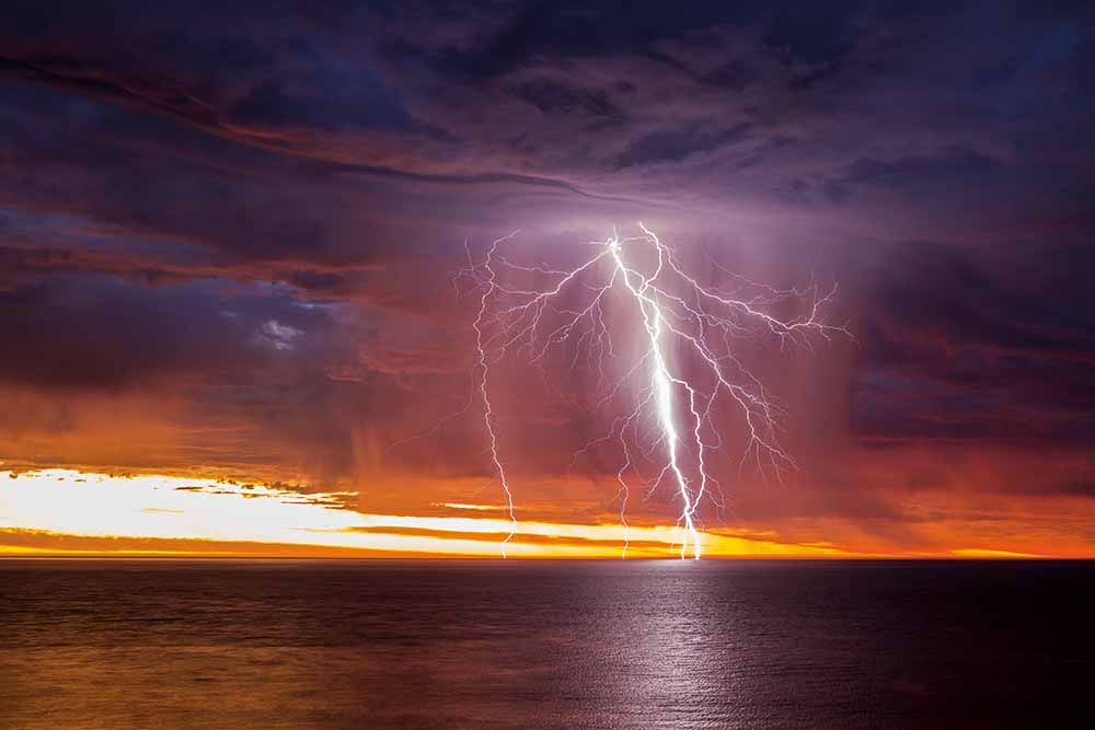Sunset-lit lightning over Gulf St Vincent, South Australia, 21 January 2018—Rowland Beardsell