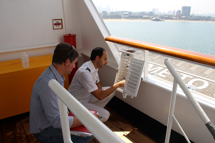 Image: The Port Meteorological Officer assists crew to maintain observation equipment aboard one of the ships in the Australian Voluntary Observing Fleet