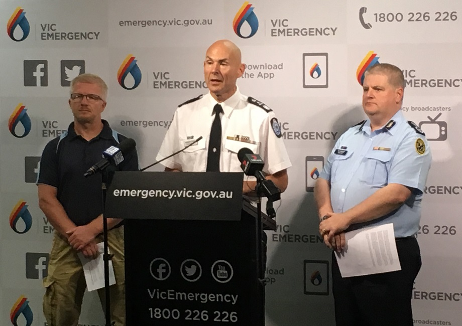 Kevin Parkyn,  Emergency Management Commissioner Andrew Crisp, Victorian SES Chief Operations Officer Tim Wiebusch front the microphone at a press conference