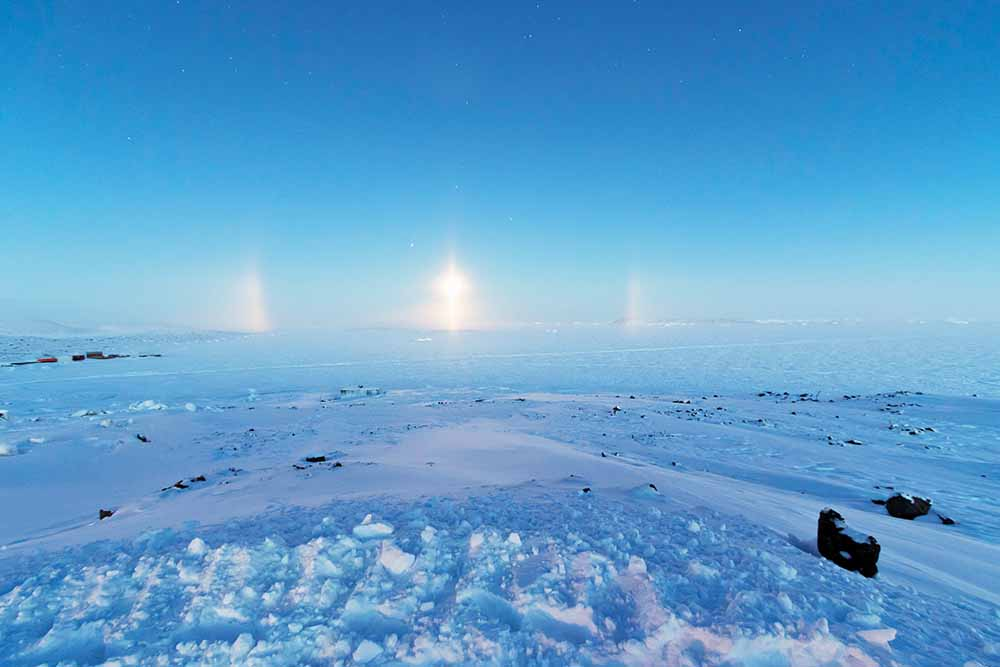 Diamond dust, partial 22° halo and light pillar over Prydz Bay, Davis Research Station, Antarctica