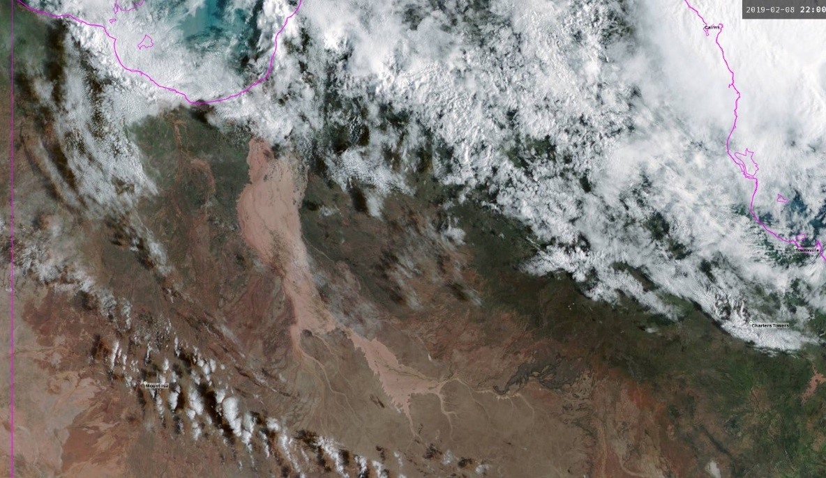 Satellite image of western Queensland showing extensive brown flood waters in the Gulf of Carpentaria and a long way south of there.
