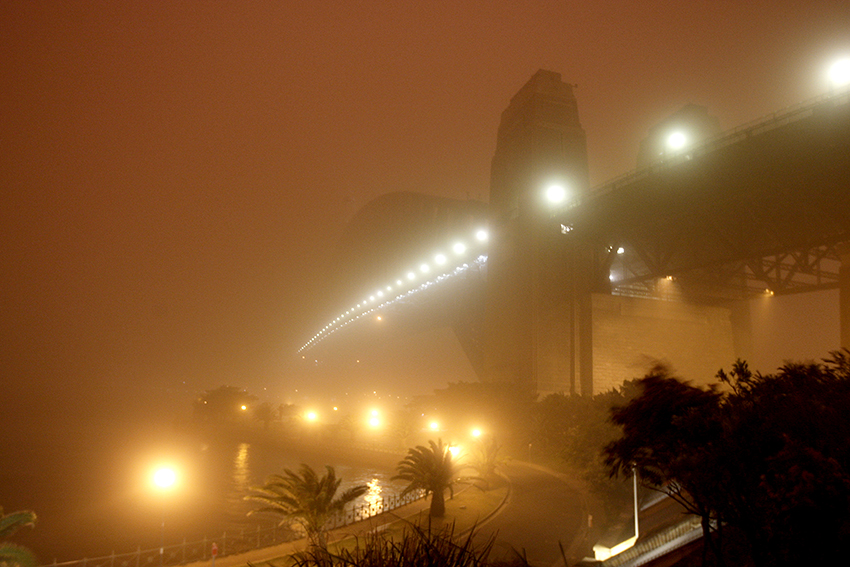 Sydney Harbour Bridge during Red Dawn, 5.32 am 23 September 2009. Credit: John Grainger