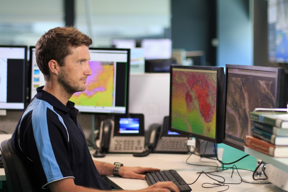 Image: A meteorologist at the Bureau's National Operations Centre